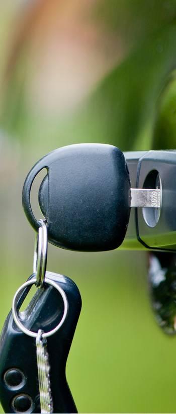 close up of car key in a car door key slot