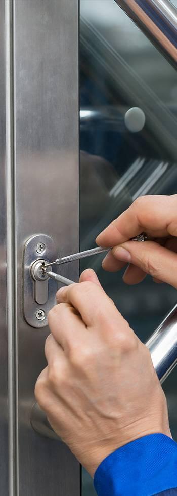 locksmith opening a commercial metal door
