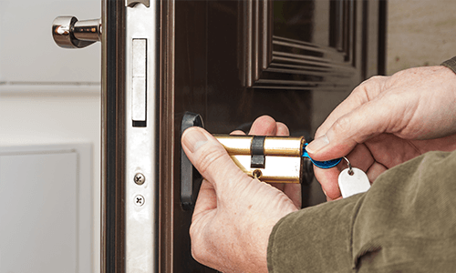 a locksmith opening a domestic door