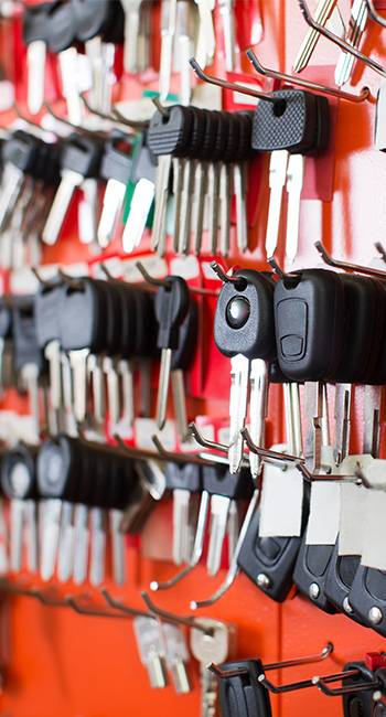 Car keys hanging on a key rack